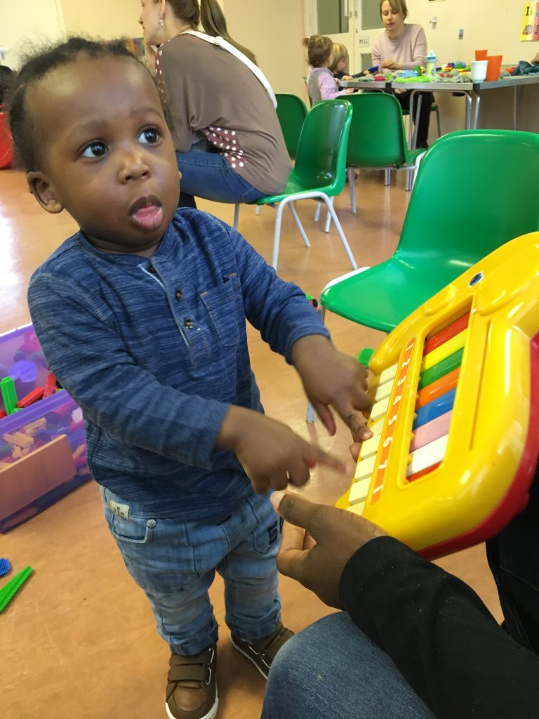 Parents and Toddlers enjoying music and crafts